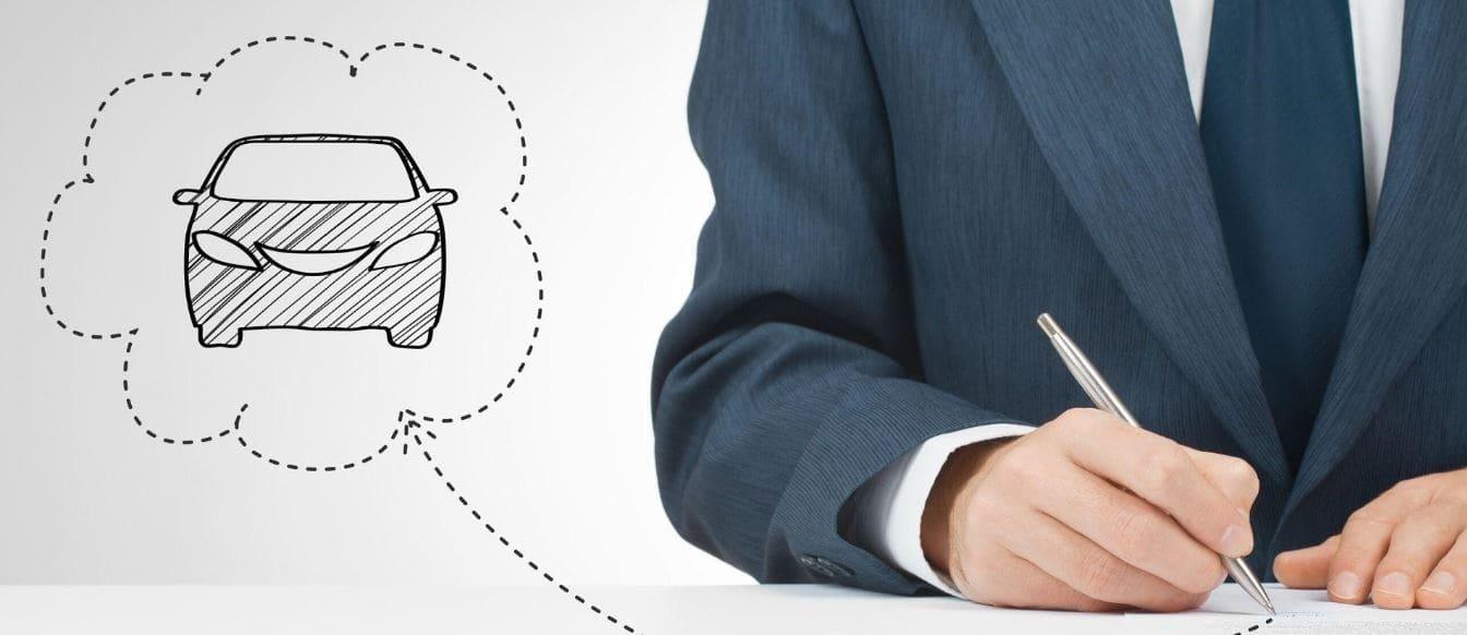 Man wearing suit writing