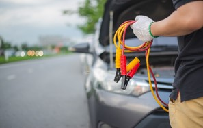 Man holds jump start cables