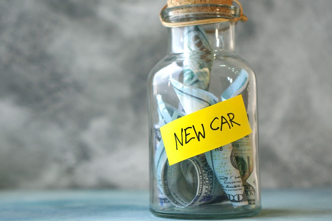A glass bottle saving for a new car